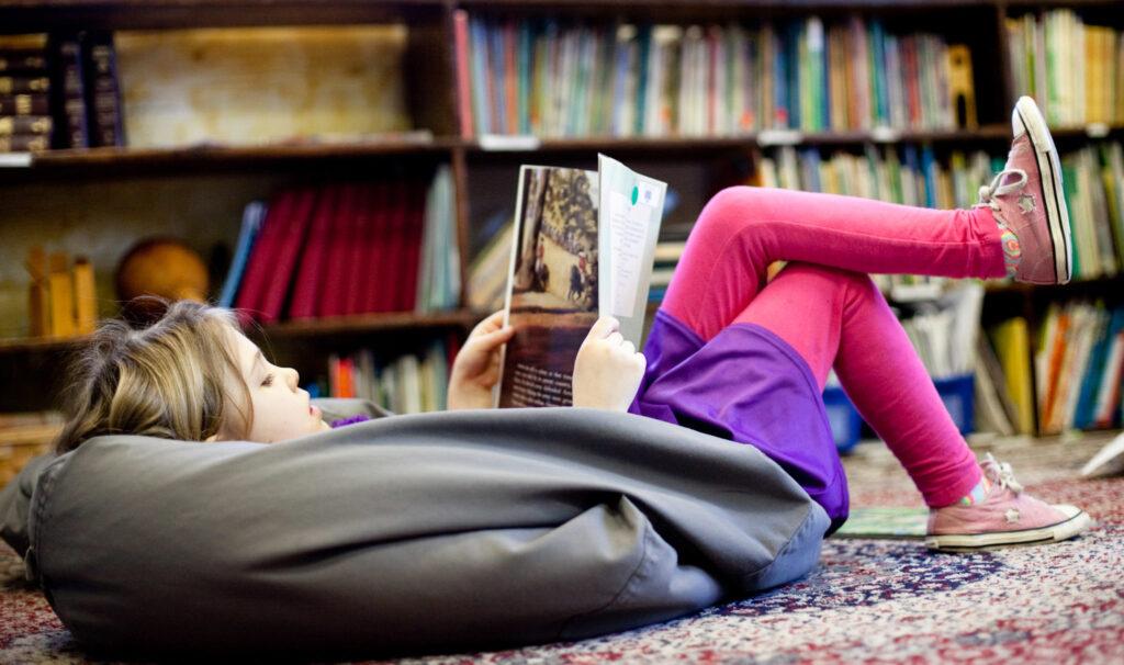 girl reading on bean bag